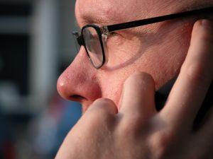 Senior Executive answering a phone call from an executive recruiter